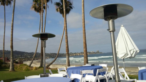 ocean, palm trees, La Jolla pennisula, green lawn with white chairs; breakfast view for lipids conference